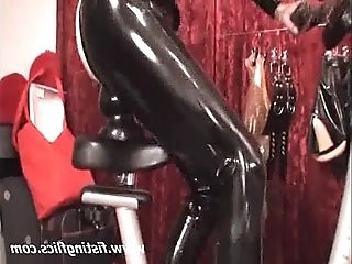 XXL butt plug fuck on a bike seat
