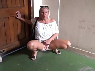 Mature flashing mum outdoors with their sexy exhibitionist milf Jerry showing tits and