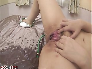 Minako Uchida getting naked and fondling her eager pussy with vibrator