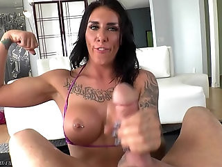 Dominating beauty licks her slaves balls