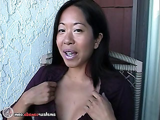 Asian Mame flashing huge natural boobs on a balcony in Canada
